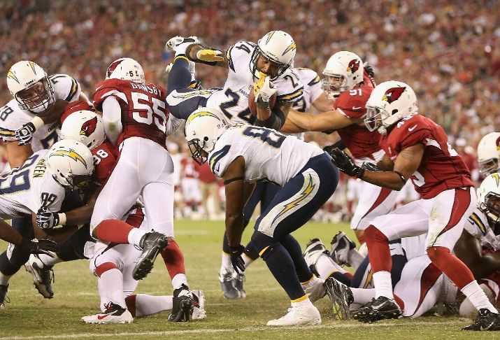 Running back Ryan Mathews #24 of the San Diego Chargers attempts to dive into the end zone before scoring a 1 yard rushing touchdown against the Arizona Cardinals during the first quarter of the preseason NFL game at the University of Phoenix Stadium on August 24, 2013 in Glendale, Arizona. (Photo by Christian Petersen/Getty Images)
