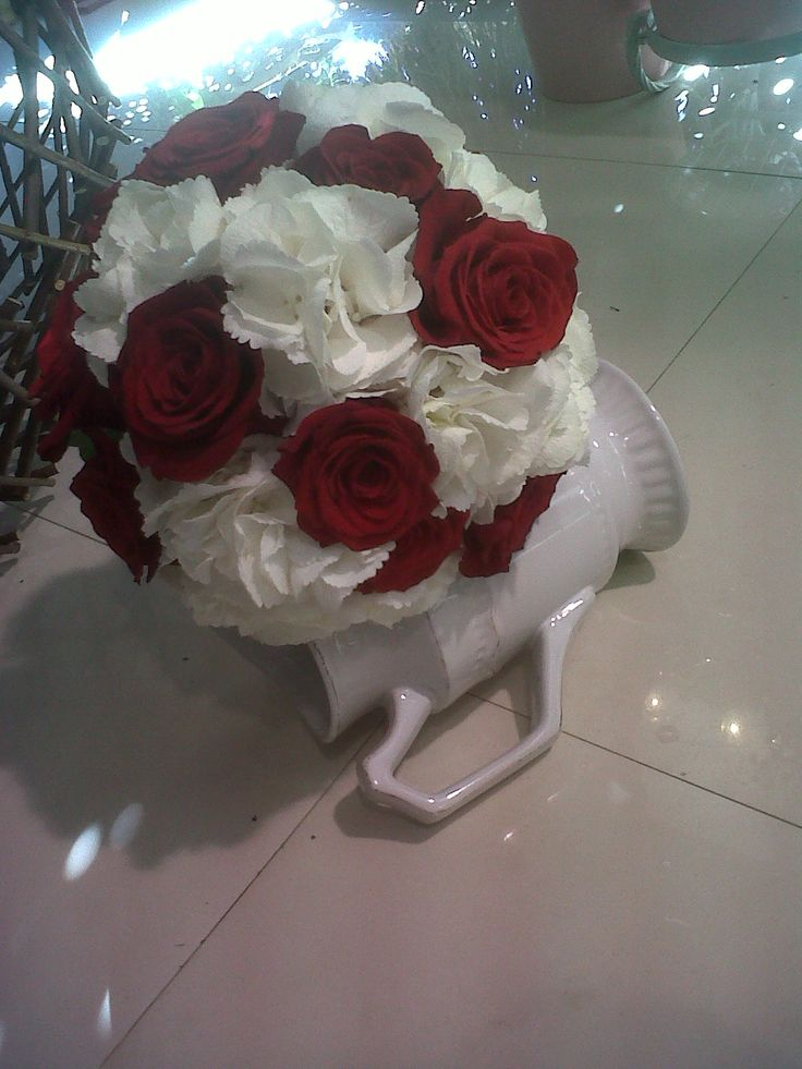 Bridal bouquet made with Freedom roses and white hydrangea