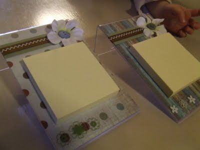 Post-it holders... Made with those cheap plastic 4x6 frames... dollar store.
