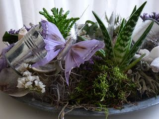 Zomerse krans - Tillandsia, zilvermos voor een mooi contrast bij de paarse limonium. Creatief met Statice!