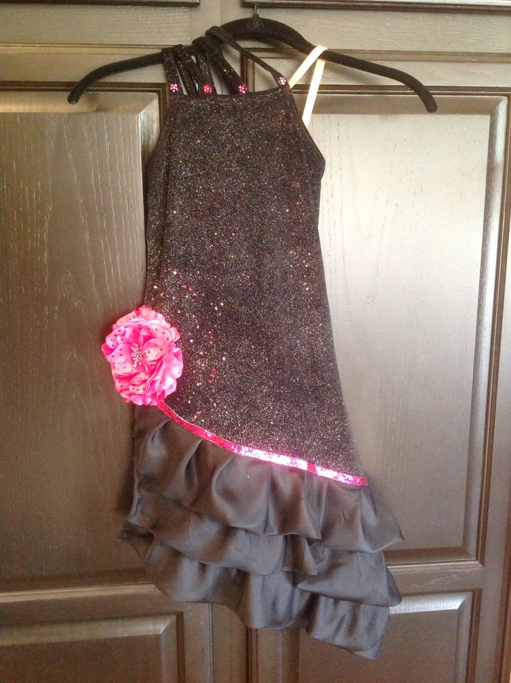Sewed ruffles to the dress and added sparkly ribbon and crystals to flower and dress for Emily's FS1 dramatic program (Carmen).