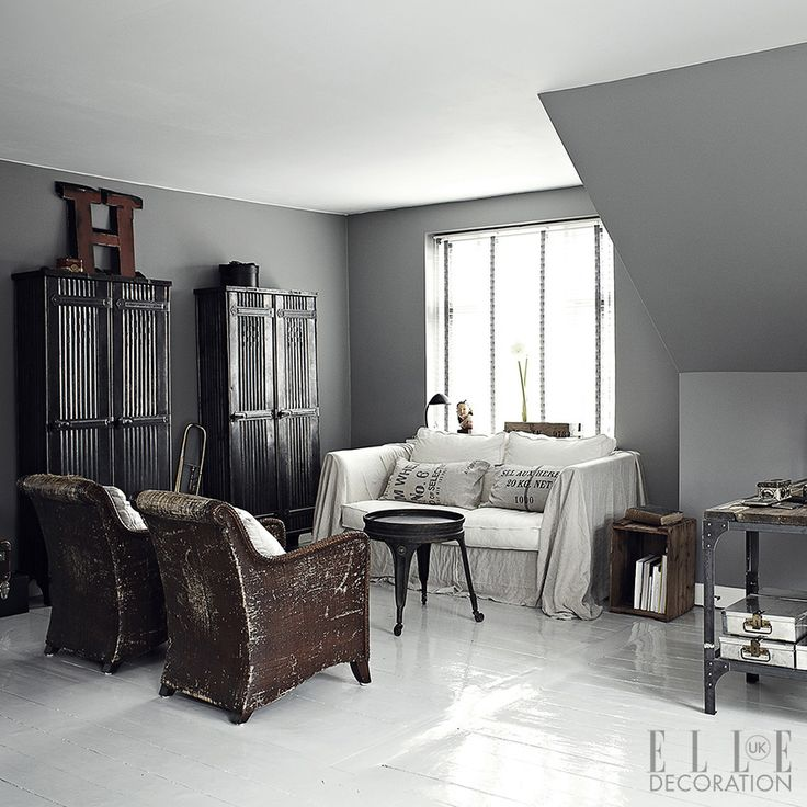 This pared-down palette creates a cool canvas for a Danish couple's collections of 1940s and 1950s furniture (sourced mainly from France) in their Fredensborg home. Wicker chairs are teamed with a simply draped sofa alongside edgier, industrial-style cabinets and a metal table from Fil de Fer (fildefer.dk)<span>Photography: Mikkel Russel/House of Pictures</span>
