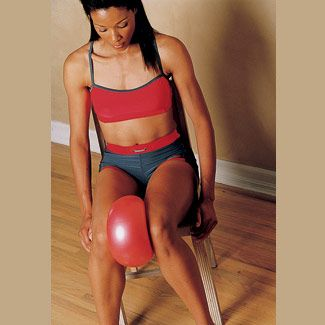 Ball Squeeze- 1. Sit in a chair, leaning slightly forward, arms at sides, feet flat on the floor. Place a medium-size ball between your legs above your knees, with just enough pressure to hold the ball in place. 2. Squeeze the ball with your inner-thigh muscles. Then release just enough to hold the ball in place. Start with 10 squeezes; work up to 30.    Muscles it works: Inner thighs
