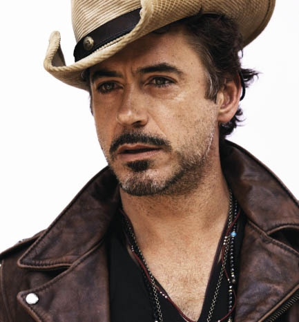 Robert Downey Jr. My personality twin in the movie Due Date.. he's also pretty bad ass as Iron Man :-) Not even naming older stuff..