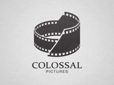 I LOVE this logo! It's so creative-- the mark uses film and the shape of the Colosseum. It depicts all the parts of the company name.
