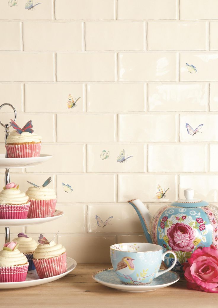 Bring the natural world into your home with this delicate, colourful butterfly tiles. Available in rustic bricks or field tiles, in full colour or muted grey. Handmade ceramic tiles, made in the UK. winchestertiles.com