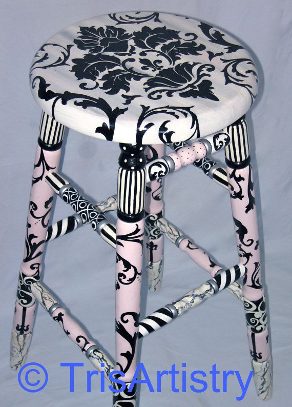 This Whimsical Stool is sure to be noticed. Constructed of Solid Oak, Primed, then Hand Painted with Pink, Black & White Flourishes, Stripes, Dots & Brocade Designs , accented with silver. This Piece is Primed , Painted with several layers of Paint, & Finished with four coats of Polyurethane. Measures 30 1/4 tall X 15 3/4 X 15 3/4. There are several items in my shop in a similar design. Wipe clean with a soft cloth & warm soapy H20. If you feel that the shipp...