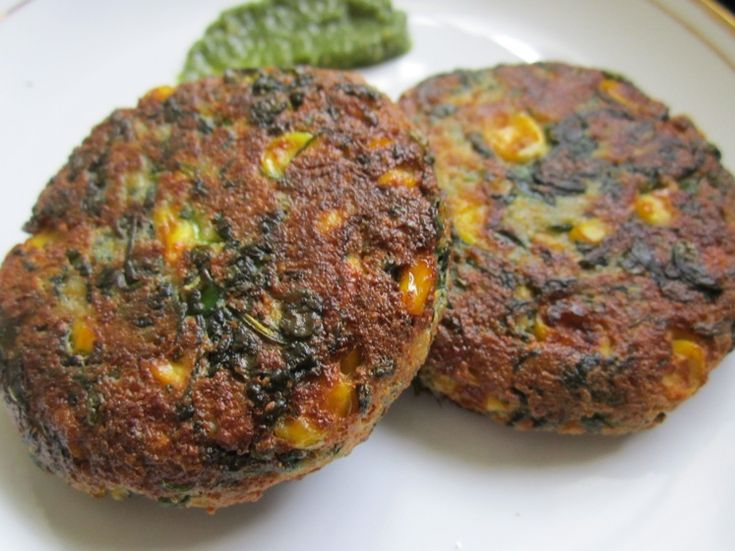 Share this on WhatsAppSpinach and Sweet Corn Tikki Recipe | Corn-Palak Tikki | Spinach and Sweet Corn Patty Recipe Hey foodies! Today I am sharing an easy and healthy snack recipe. It's theSpinach and Sweet Corn Tikki orPatty. This snack is the best way to make your kids eat spinach, if they do not like it. Besides, this is not a deep-fried snack. I have shallow-fried it in nonstick pan