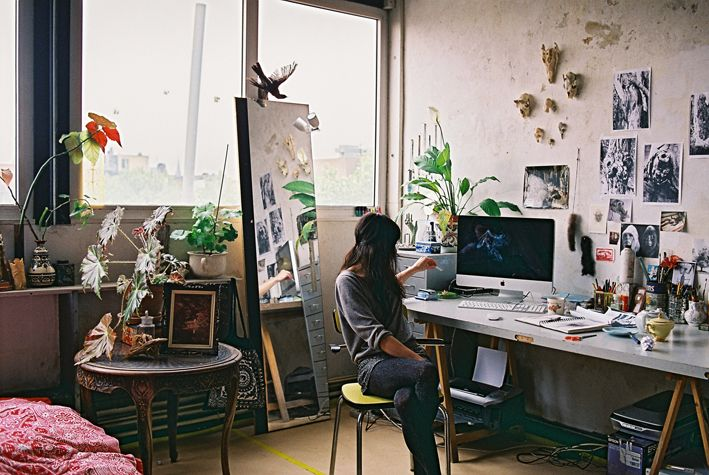 artists home with inspiration on the wall and plants