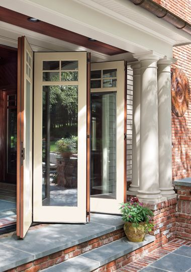 Operable wall in traditional style; Leanza Bi-fold by Marvin Windows & Doors.  I want one of these for my living room - just have to take out a wall and build a porch :)