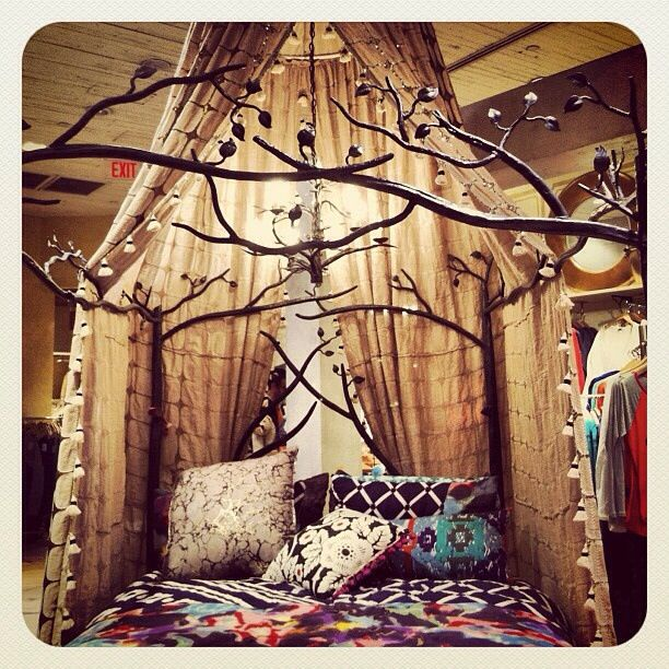 It would be fun to paint branches, add some preserved flowers and fairy lights around a regular bed frame or above floor futon....