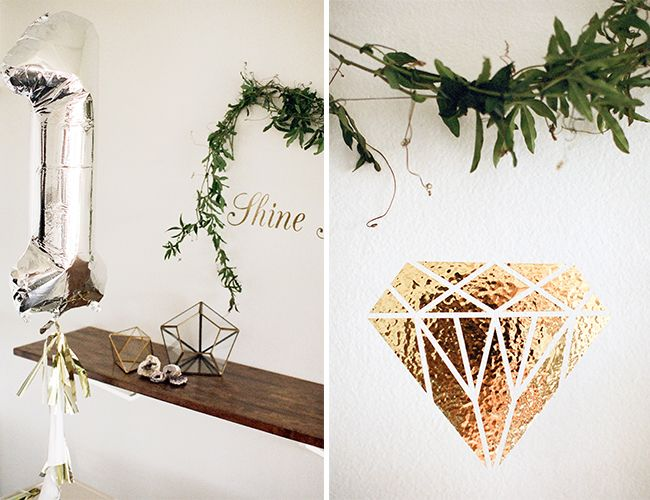 """An abundance of wall decals including gems and a """"shine bright like a (diamond)"""" sayings amped up the white walls"""