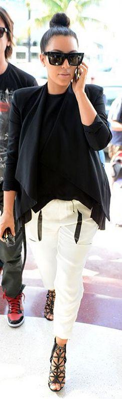 Kim Kardashian : Pants – Helmut Lang    Wallet – Chanel    Shoes – Givenchy    Sunglasses – Celine