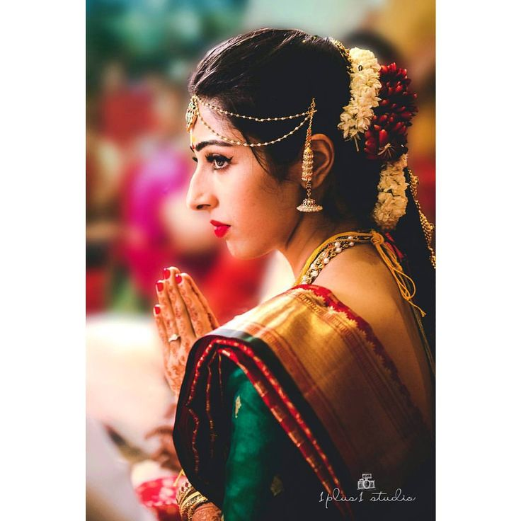 South Indian bride. Gold Indian bridal jewelry.Temple jewelry. Jhumkis. Red silk kanchipuram sari with green blouse.Braid with fresh flowers. Tamil bride. Telugu bride. Kannada bride. Hindu bride. Malayalee bride.Kerala bride.South Indian wedding.