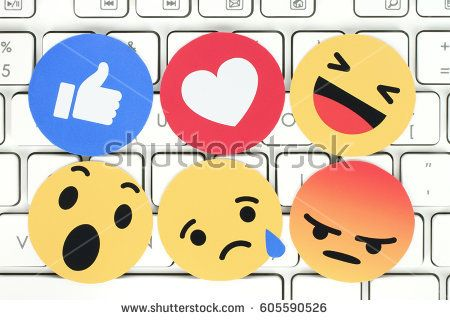Kiev, Ukraine - February 07, 2017: Facebook like button 6 Empathetic Emoji Reactions printed on paper and placed on computer keyboard. Facebook is a well-known social networking service