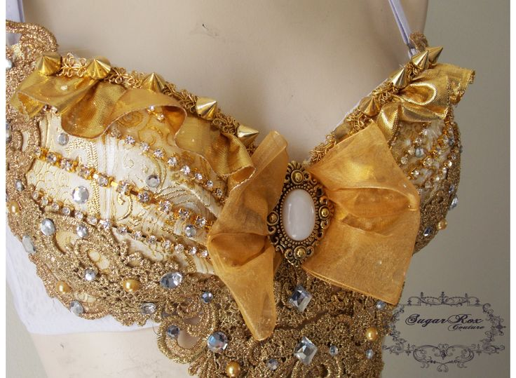 Gold Queen outfit- Gold  rave bra, custom event outfit- rhinestones, crystal chain, ruffles. $155.00, via Etsy.