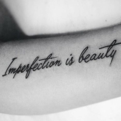 Forearm tattoo saying Imperfection is beauty on...