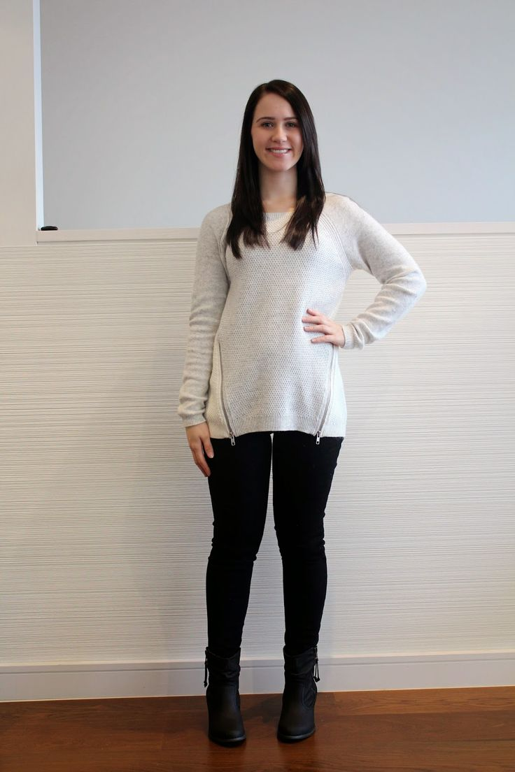 Winter knitwear: black jeans, neutral jumper, black booties