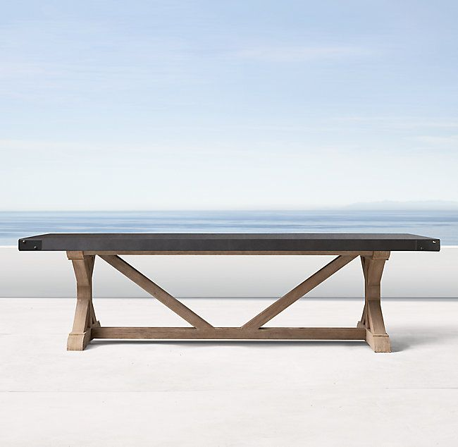 RH's Belgian Trestle Concrete & Teak Rectangular Dining Table:Our eclectic table pairs stout teak beams with an equally sturdy concrete top for a mix of materials that will age beautifully outdoors. Aluminum banding encircles the table's apron.
