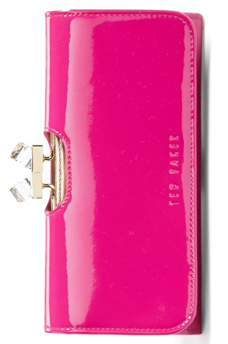 This hot pink wallet is so cute - it could definitely be carried as a chic clutch, too.