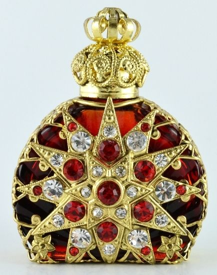 Red crystals and filigree perfume bottle