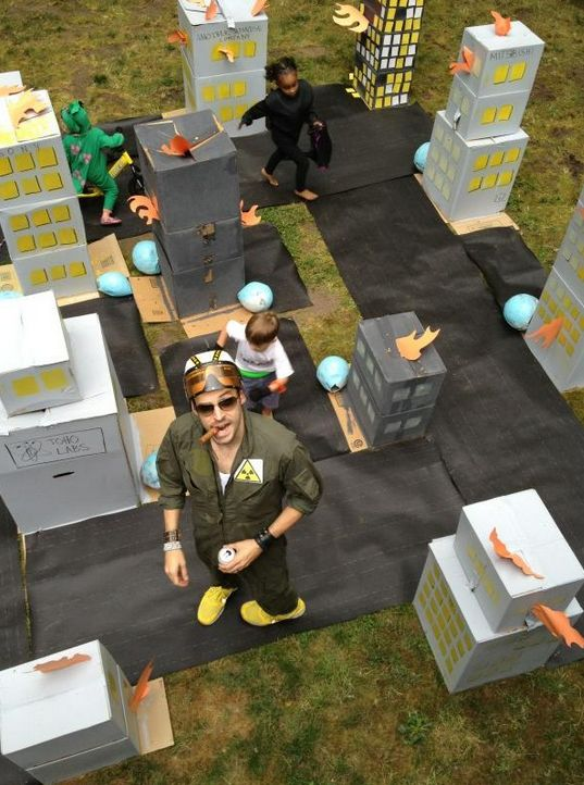 Adorable kaiju birthday party has five-year-olds smashing a cardboard city