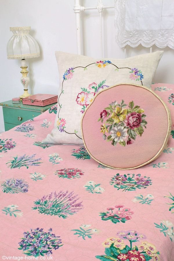 A pretty 1940s floral linen bedspread and embroidered cushions on the guest bed: www.vintage-home.co.uk