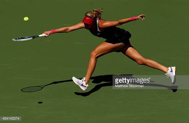 Danielle Rose Collins of the United States returns a shot against Simona Halep of Romania during their women's singles first round match on Day One...