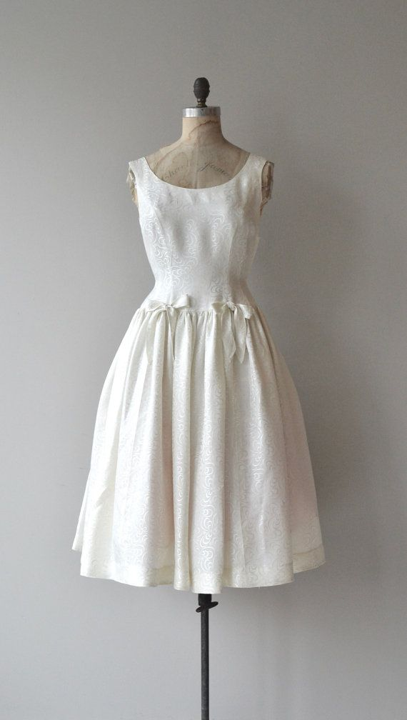 Vintage 1950s silk wedding dress with tonal swirl pattern, princess seamed bodice, gathered low waist with bows, full skirt and metal side zipper. ---