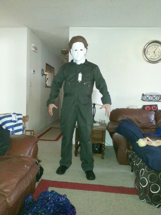 Trial fitting of Michael Myers mask and original olive green coveralls.