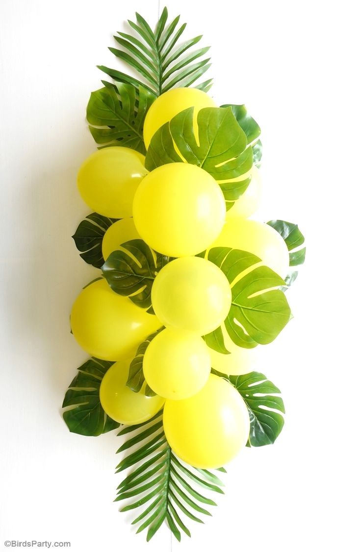 DIY Balloon and Fronds Tropical Party Table Centerpiece Garland. Learn how to DIY and make this easy table decor for your summer party table! You could also use as a background in a party photo booth.