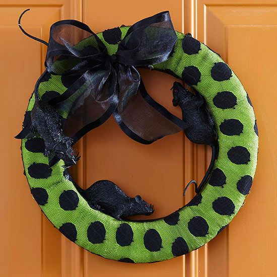 Try this colorful, ever-so-slightly creepy wreath, festooned with lacy, dotted fabric and faux rats: http://www.bhg.com/halloween/outdoor-decorations/halloween-outdoor-makeover/?socsrc=bhgpin102414polkadotwreath&page=11