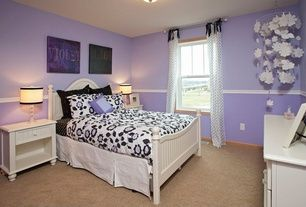 Eclectic Kids Bedroom with double-hung window, Standard height, Chair rail, can lights, Carpet
