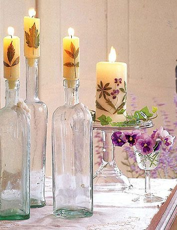 Affix leaf, dried flower etc. to candle, then dip into clear wax. LOVE this!  Country Living.com