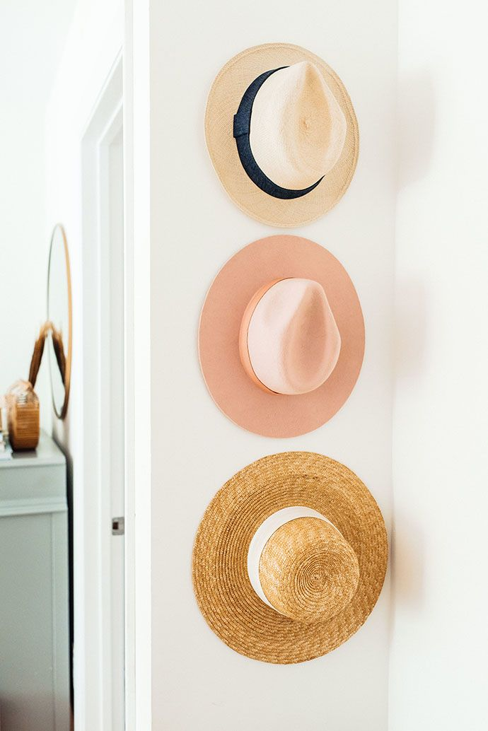 hats hung on the bedroom wall