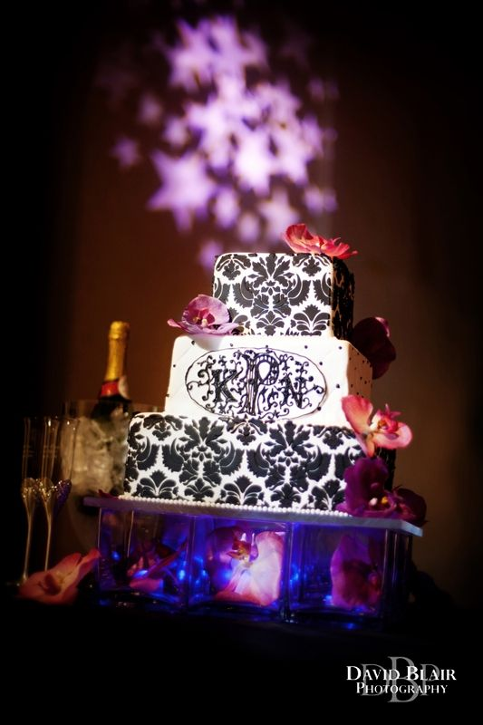 Beautiful Wedding Cake Positioned With Star Lighting Behind Photo By Louisville Photographer David Blair