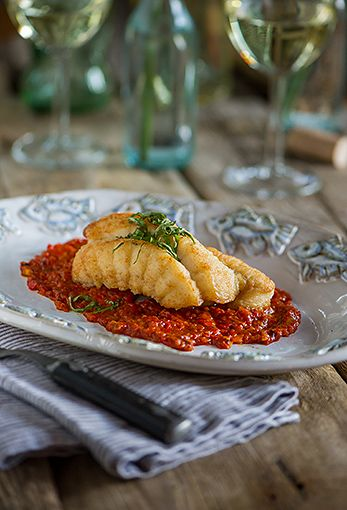 Photo of Pan Seared Monkfish Over Roasted Tomato Pepper Sauce