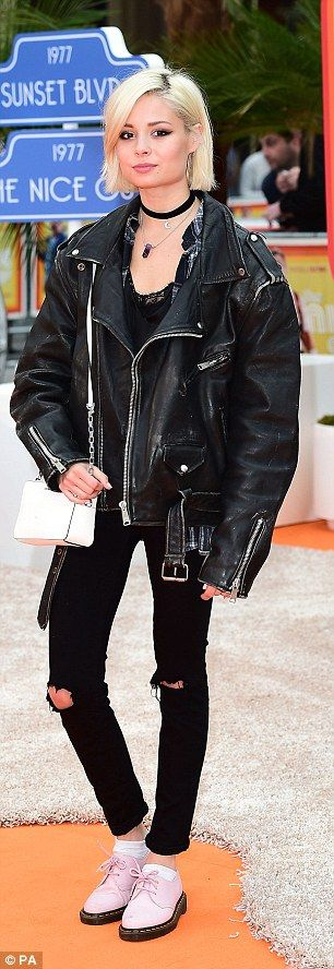 Rock 'n roll: Nina Nesbitt pulled off the rock chick look to perfection with an oversized leather jacket, torn skinny jeans and a choker