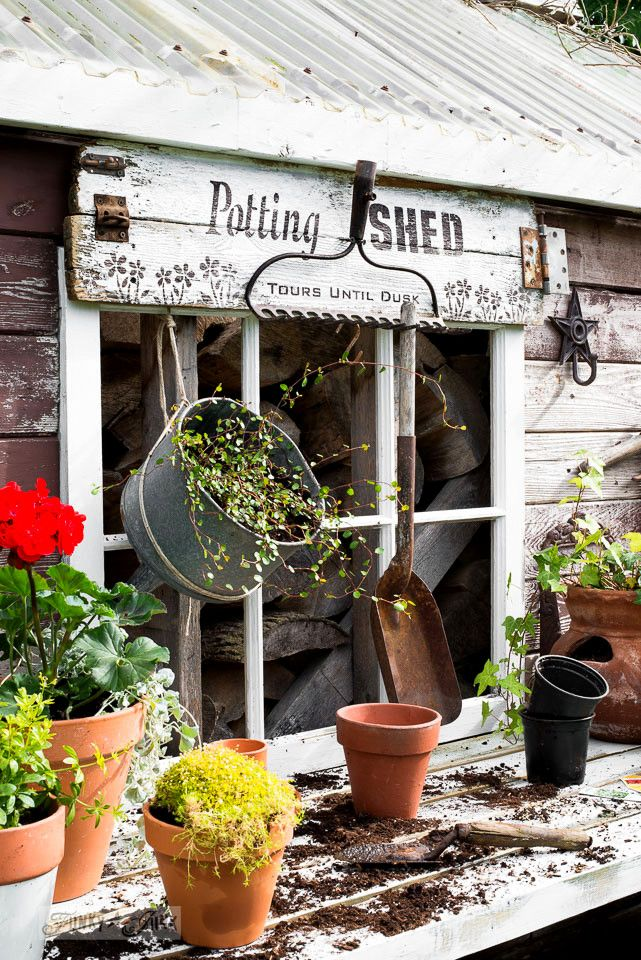 Potting shed sign with old rake garden tool hanger, on a rustic garden shed : made with Funky Junk's Old Sign Stencils | funkyjunkinteriors.net