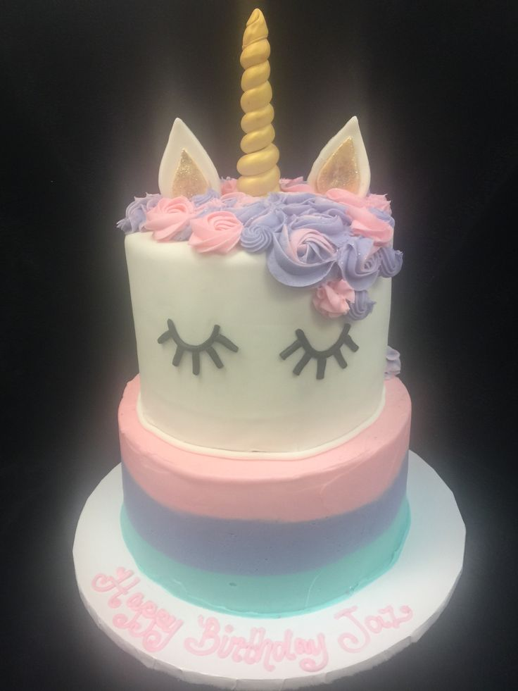 Unicorn tiered birthday cake.