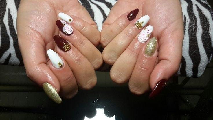 White-gold glitter-bordeaux, ballerinashaped, acrylic manicure with 3D roses, caviar beeds and golden studs.
