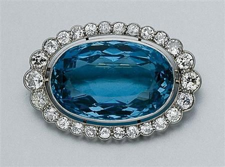 Aquamarine and Diamond Brooch   Platinum, centering one oval aquamarine, approxi...