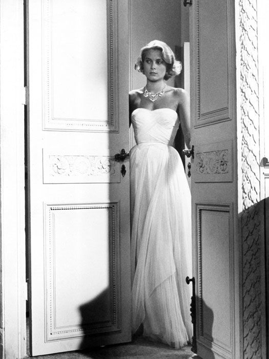 Grace Kelly in the gorgeous blue gown.  Why Good Housekeeping used a black and white for this gown is beyond me. They rank it as  one of the 100 Most Memorable gowns of all time.