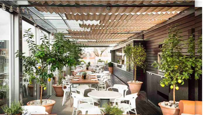 Boundary Rooftop, Shoreditch. Provençal-style rooftop summer menu. Heated orangery. Gin&Tonic or Long Drinks £10.50 - £12.50