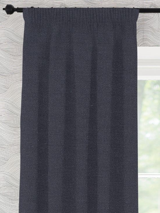 Falcon is a textured, midweight, 100% cotton fabric in a rich, deep navy blue/black. Made right here in the UK, all our ready made curtains are available in unique extra long and extra wide sizes and with a thermal blackout lining option.