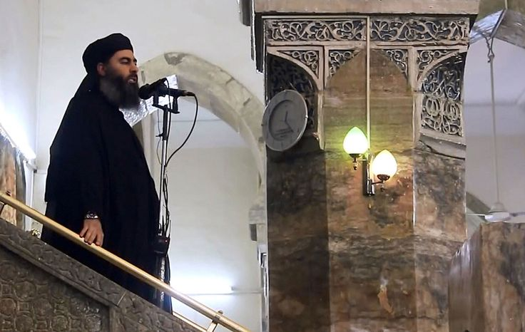 The leader of the Islamic State, Abu Bakr al-Baghdadi, preaches during Friday prayer at a mosque in Mosul, Iraq.