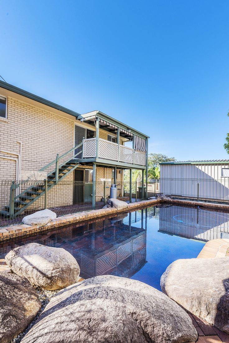 MCDOWALL 15 Calhoun Street...Commanding a stately street presence complimented by a quiet cul-de-sac locale this home boasts two generous levels of living perfect for the family that is starting out or expanding