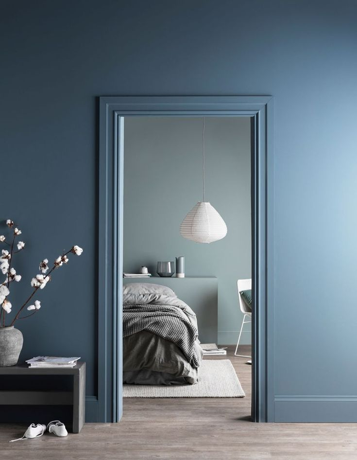 Blue and light grey color combo in bedroom.
