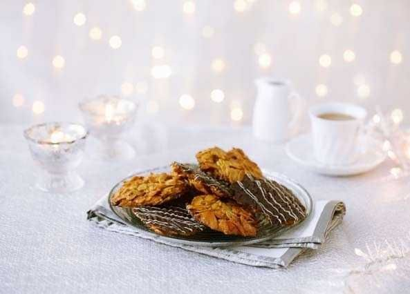 If you love nuts, these biscuits are a must. A flour-free recipe, baked in minutes and coated in lashings of chocolate
