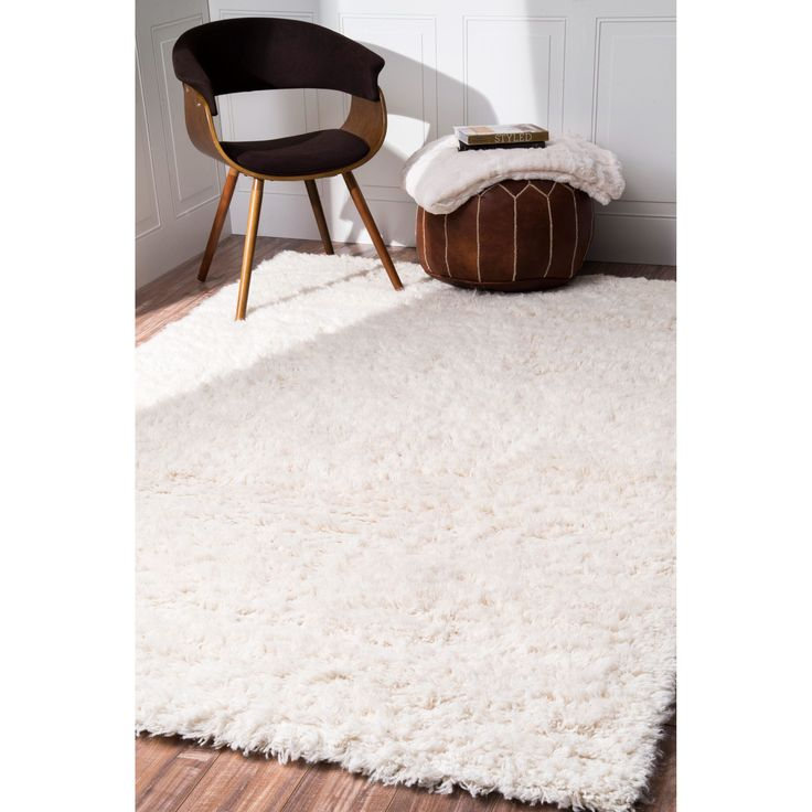 This handmade wool area rug features an elegant mixture of New Zealand and Indian wool. This soft and plush area rug was meticulously handcrafted to create a luxurious boldness and softness under foot.